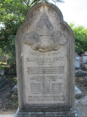 Baumhorn's gravestone bears a carving of the great dome of his masterpiece, the synagogue in Szeged, Hungary, and also a list of more than 20 other synagogues he designed or remodeled. It also has a very flowery poetic epitaph.